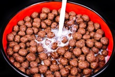 13005297 - breakfast cereals, chocolate balls  the photo on black background